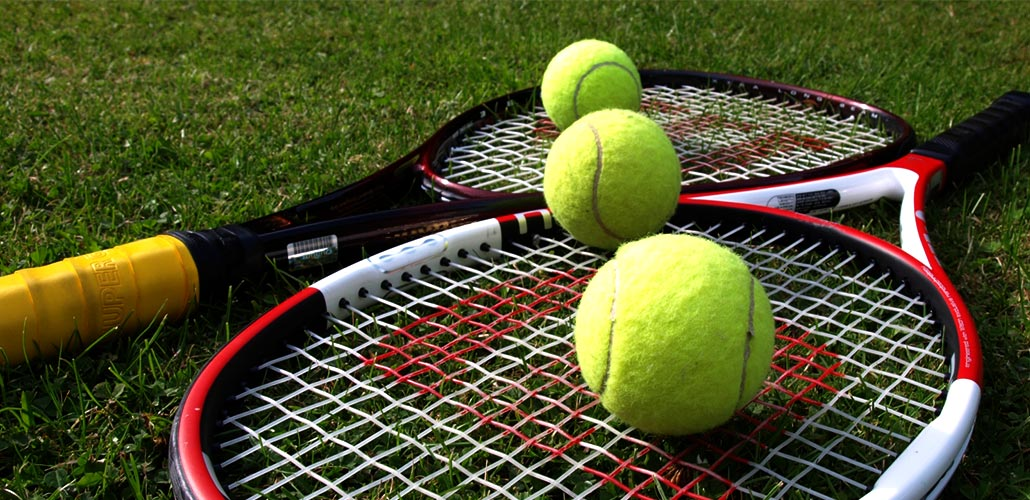 three-tennis-balls-and-two-rackets